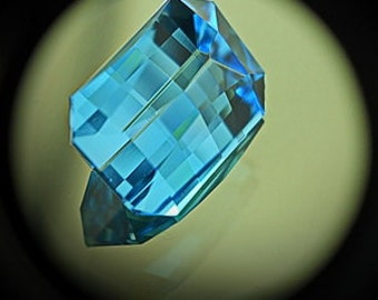 Blue Topaz | 6.50ct | Precision Cut | Checkerboard Design With Unusual Shape. Nice Mirror Type Of Flash Goes From Direction To The Other