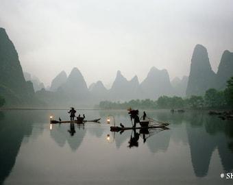 Fishermen in China with cormorant birds on Li River.