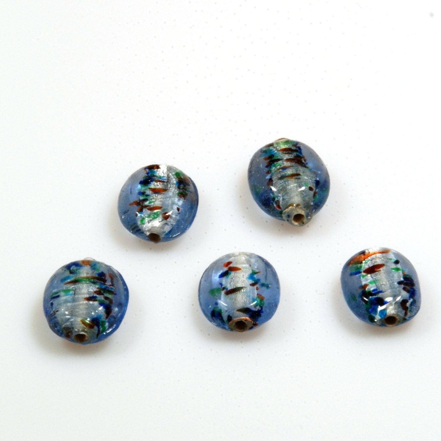 Silver foil glass beads in light blue with colored stripes