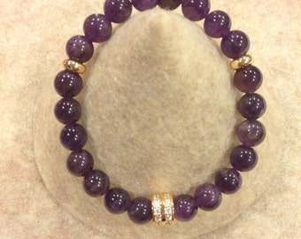 Genuine Amethyst stretch bracelet with Gold plated details