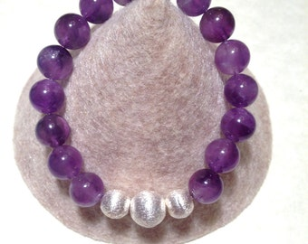Genuine Amethyst stretch bracelet with brushed sterling silver beads