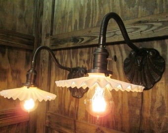 Pair of 1908 Early Industrial Age Brushed Steel Gooseneck Wall Sconces With White Opalescent Glass Petticoat Shades