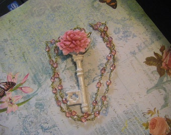 White shabby key necklace with pink faceted crystal beads     25 inches long