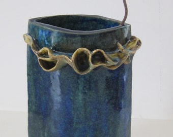 Blue ceramic vase with organic green decoration