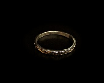 14 Karat soild gold wedding ring, decorated with floral engraving.