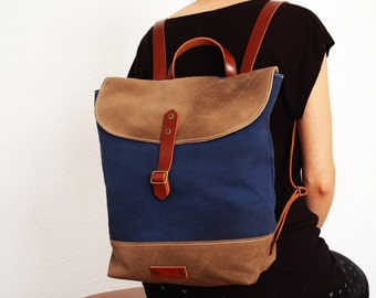 Waxed canvas rucksack/backpack, navy blue color,base stone gray, with handles, leather  ,hand wax