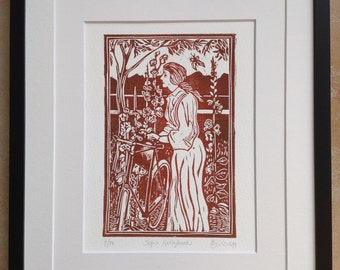 Sepia version. Original hand carved lino cut print titled 'Hollyhocks'. 1920s Lady and bicycle with hollyhocks & butterfly