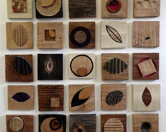 Shaker Collective No.1 a series of oak relief tiles.