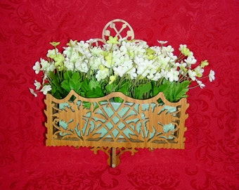 fretwork wall hanging, can take flowers out and use it for a mail holder