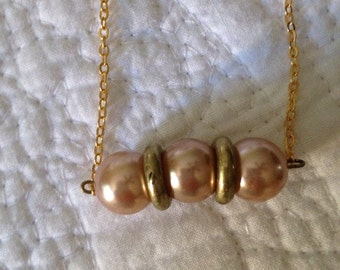 Vintage Pink/champagne colored pearls on gold toned chain