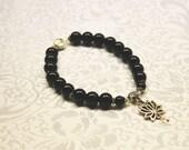 Black Onyx beaded bracelet with silver flower charm