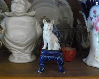 old miniature of 'cat sitting on a chair'