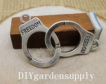100pcs 15x24mm antiqued silver freedom handcuff zinc alloy charms findings