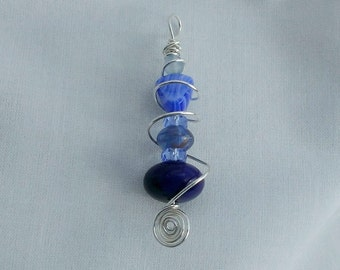 Wire wrapped pendant. Handmade, silver plated wire, Czech glass beads.