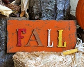 "Rustic Metal Sign with 4"" Letters Spelling FALL - chippy paint, rusty finish on orange rusty metal background"