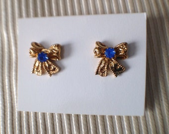 Pair of Vintage Avon New in Box Goldtone and Simulated Saphhire September Birthday Bow Earrings
