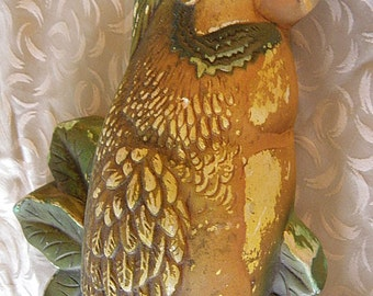 parrot chalkware hands on wall