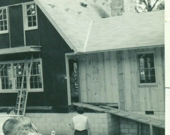 New Garage For New Car A Frame House Little Girl With Grandpa Looking At Construction SC 1963 Vintage Black White Photo Photograph