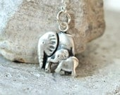 Silver mother and baby elephant pendant on sterling silver chain. Proceeds to charity, The David Sheldrick Wildlife Trust.