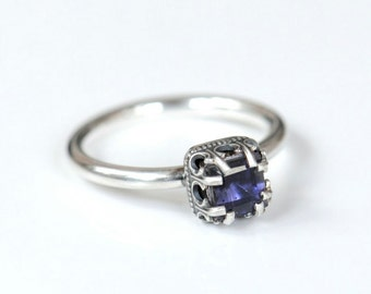 Iolite ring. Sterling silver ring with square stone. Size 8.