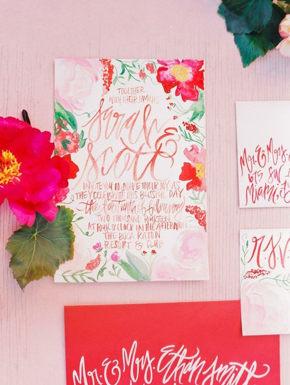 Watercolor blossoms painted wedding invitations