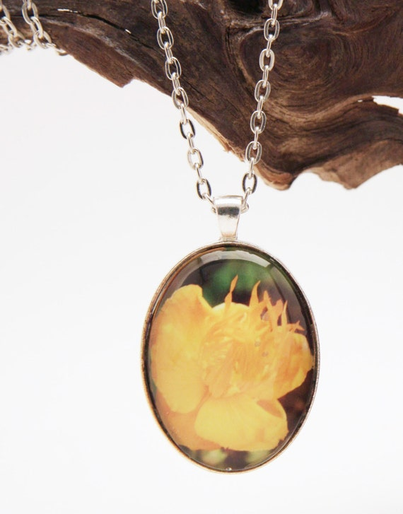 Bright yellow flower pendant in antique silver mounting