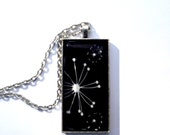 Under 6 dollars. Dandelion wish pendant.  Black and white image.  Antiqued silver. Large rectangle . Unique and Stylish
