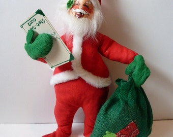 Vintage Anna Lee Santa holding notebook Good boys and girls and burlap toy bag 1971
