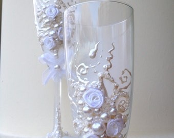 Hand decorated wedding toasting flutes in ivory and white, with fabric roses and bows