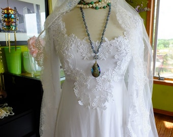 Wedding dress vintage lace rennaissance influence sleeves traditional style alternative wedding