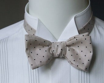 "Men's bow tie,  light beige with black pindots - cotton print - adjustable to collar size 14 to 18 1/2"" -  self-tie for men."