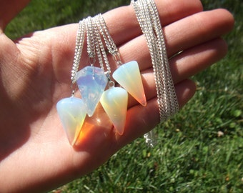 One Hypnotic opalite pendulum/necklace also used for divination and dowsing comes on 24 inch long chain