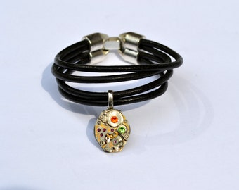 Black leather bracelet with vintage watch movement and swarovski crystals