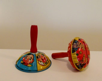 Two Tin Noise Makers Pair of Lithographed Metal with Wooden Handle Toys
