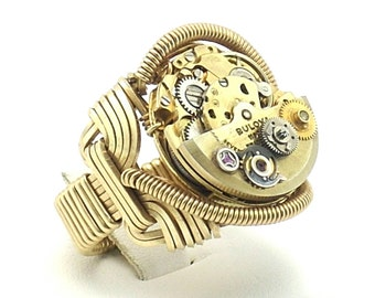 Steampunk red brass wire wrapped Pharaoh ring, automatic Bulova movement with watch parts. SIZE 9.5 ooak!