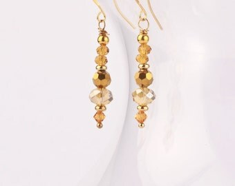Dripping in Gold Swarovski Crystal and Glass Bead Dangle Earrings