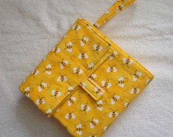 flip and go travel diaper changing pad/baby changing pad/travel diaper clutch with pockets - yellow busy bees
