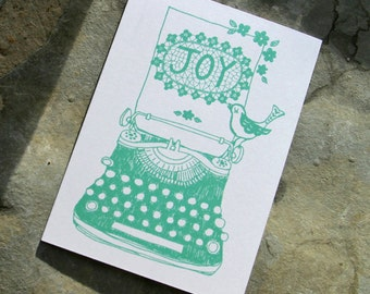 illustrated typewriter greetings card, bird and JOY in mint.  Printed on FSC accredited card.