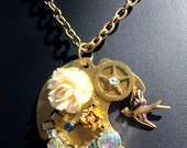 Shabby chic/steampunk  watch base pendant with watch parts, vintage collaged pieces and a bird necklace