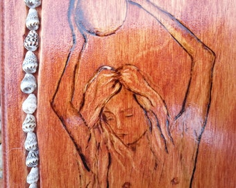 """woodburning of a  mermaid named """"Cleodora on a greek paddle home decor wall hanging"""