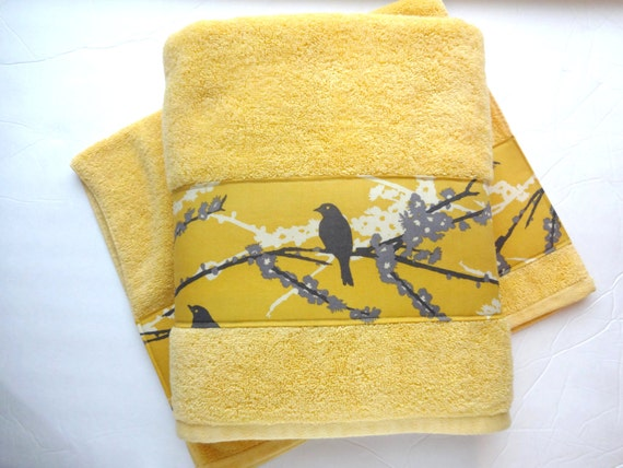 Regular bath towels measure 27 inches by 52 to 58 inches, hand towels 16 by 28 to 30 inches and washcloths are inch square. There are also other larger types of bath towels such as the bath sheet, which is the type that fully wraps around you.