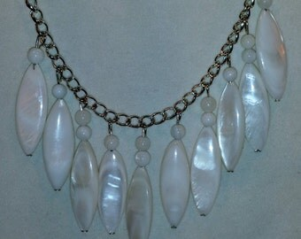 White & silver bangle necklace and earring set.