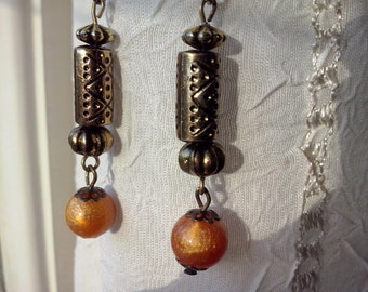 Long dangling earrings, antique golden tone earrings, with marbled orange beads and golden etched findings (ARMAN)