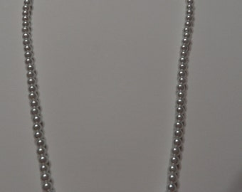 crystal pearls with pave crystal heart pendant