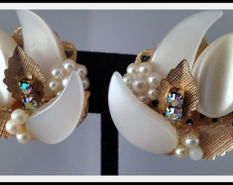 Vintage clip on white earrings with rhinestones and faux pearls and gold tone leaves