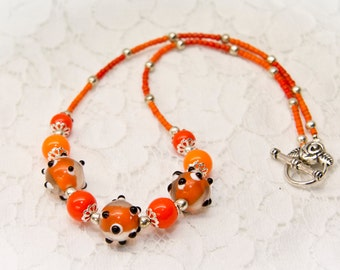 Orange necklace with Lampwork beads