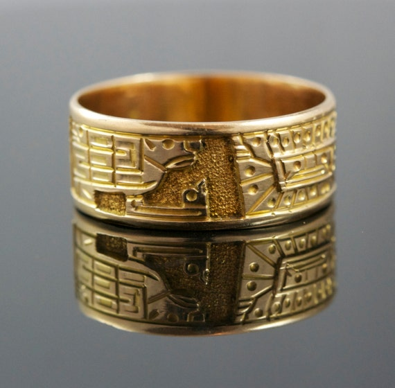 antique 14k gold cigar band ring with aztec motif circa