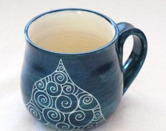 Handmade and hand decorated coffee mug dark green stoneware