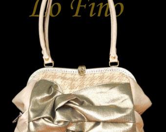 Handbag Dorada made of leather and upholstery fabric