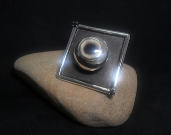 Eccentric ring in sterling silver with diamonds black and onyx